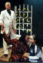 David Greenspan as Mephisto (l), George Hannah as Faust (center) and Eunice Wong as Gretchen