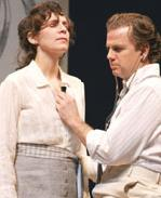 Amanda Plummer as Alma and Kevin Anderson as John Buchanan Jr.